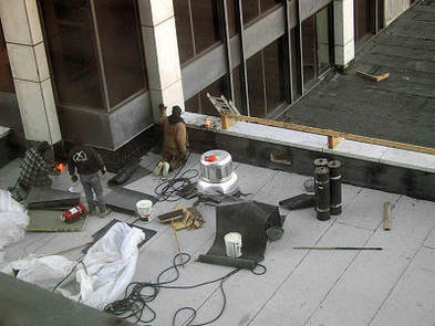 Commerciaql flat roof replacement torch-down toronto